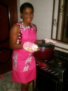 Emmanuela in pink apron